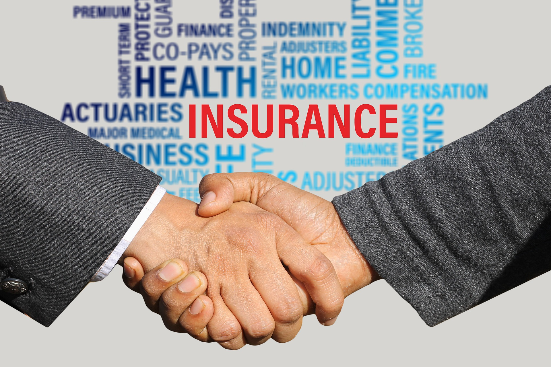 small business insurance - insurance! hand shake in front, the background has words home insurance health