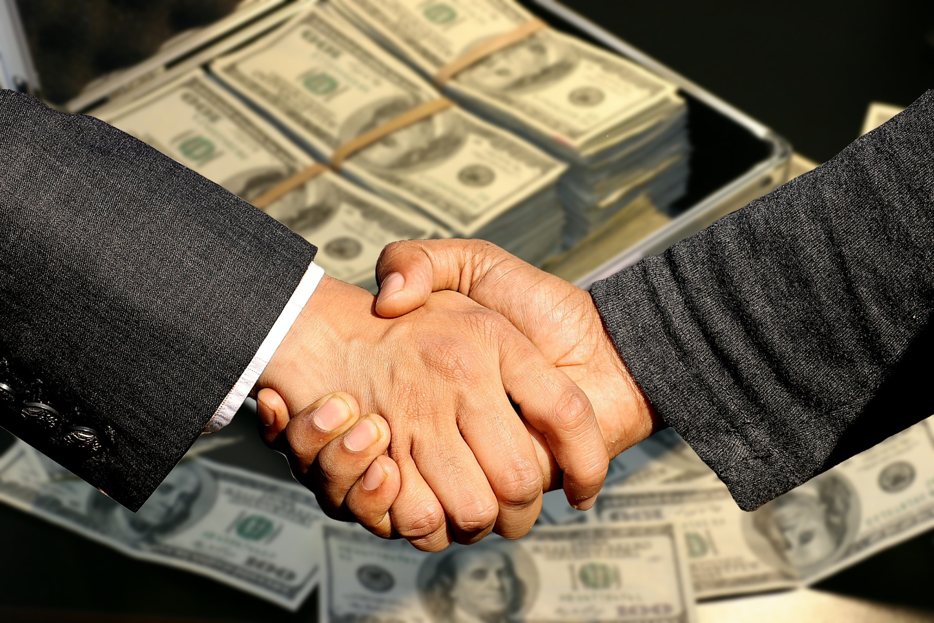 Sell a business - handshake-buyer-seller